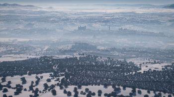 Greenpeace toma imágenes aéreas de la 'boina' de Madrid sobre una ciudad nevada